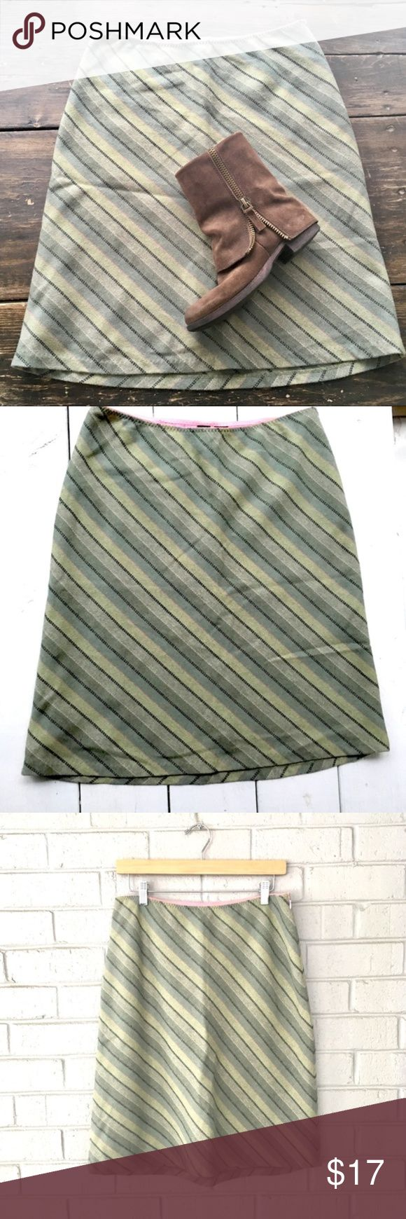 Olive Green Gap Skirt Size 8 Gently used. In great cnodition. No stains, rips or tears. Gap Wool blend skirt. 4shades of olive green stripes diagonal with cream, black and pink lines. Very cool skirt. Size 8. True to size. Fully lined with pink liner. Very cute and hobo skirt. Let me know if you need measurements. GAP Skirts Midi