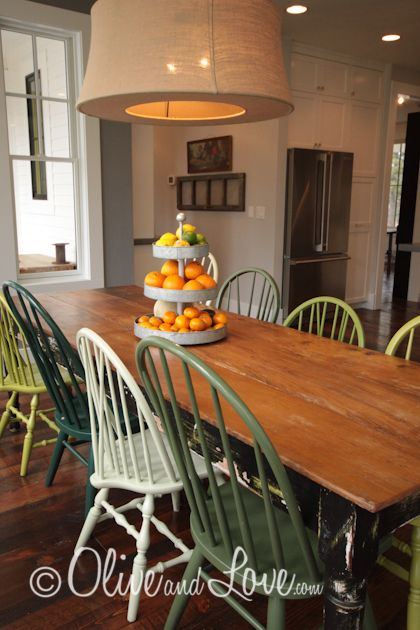 Farmhouse table, mismatched painted wooden chairs