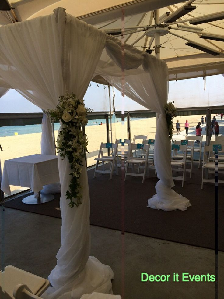 Ceremony at Sails On The Bay #beach #wedding #inspiration #decoration #beachceremony #beachweddingceremony #weddingarches #weddingbackdrop #weddingceremonydecor #weddingceremonystyling #weddingceremonyfloral  #melbournebeaches www.decorit.com.au (1)
