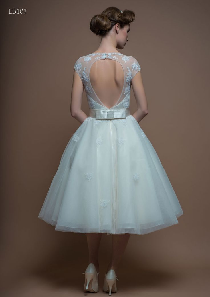 The back of Lou Lou's Molly. Beautiful tea length wedding gown, with satin bow detail and key hole back. Available at The Tailor's Cat, Cambridge 01223 366700