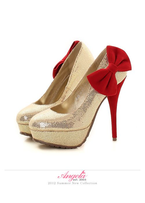 gold platform high heels with bow