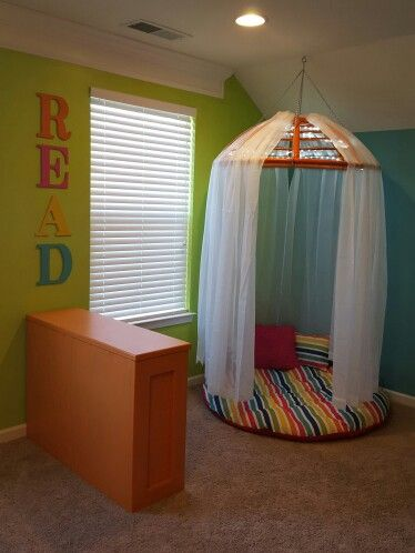 Reading nook made with an old papasan chair/cushion. Added some rope lights  for