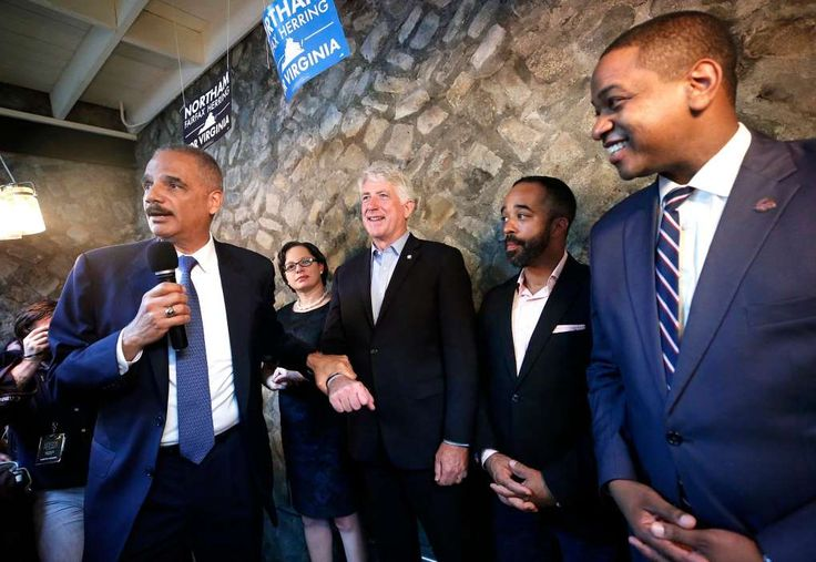 Despite Recent Wins for Democrats, Gerrymanders Dim Hopes for 2018   -  November  12, 2017.  Eric Holder, far left, the former attorney general, at a campaign event with Attorney General Mark Herring of Virginia, center, and Lt. Gov. Justin Fairfax, far right. Mr. Holder is leading an effort to challenge Republican-drawn voting maps.