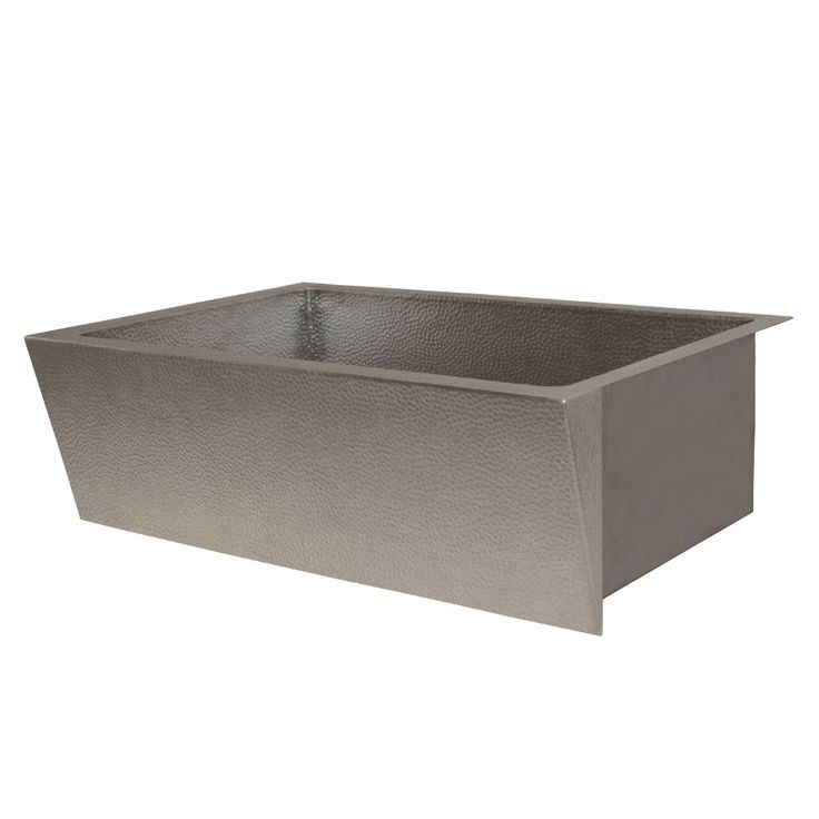 The rich, hand hammered copper of Zumas angled apron front sink is warm and versatile. Unexpected and contemporary, its statement-making design is welcomed in both a sleek, modern kitchen and a more transitional setting.