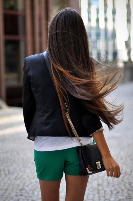 Chic green shorts paired with all the right essentials. And this girl has some phenomenal hair. Love it.