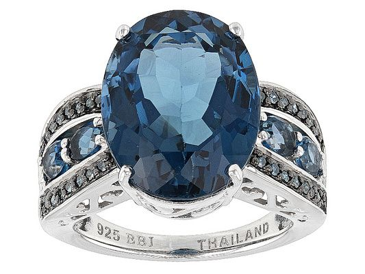 11.27ctw Oval London Blue Topaz With .15ctw Round Blue Diamond Sterlin