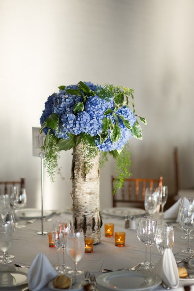 Birch-wrapped vases filled with BLUE hydrangeas- Liberty Warehouse Wedding from Robert & Kathleen Photographers