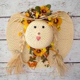 Transform your summer beach hat into a fun and whimsy fall wreath.