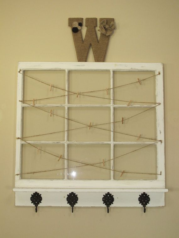 Old window with shelf for hanging photos, window picture frame