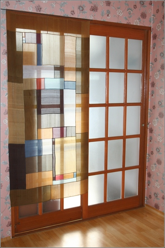 pojagi curtain - maybe for the deck door? Light filtering through looks beautiful, nice way to cove a large space especially if you have random fabric to use up