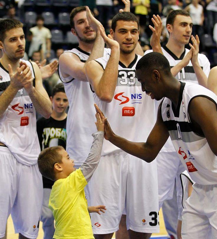 A little boy high fives with Boris Dallo (KK Partizan NIS - Radnički Kragujevac 96:78 11.05.2014)