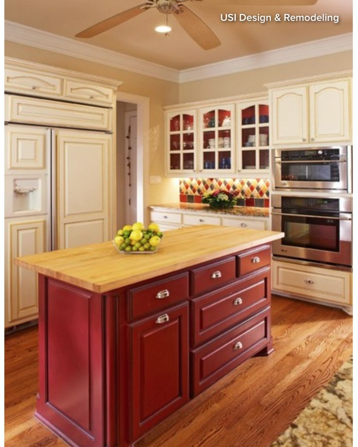 Narrow, colorful kitchen island with drawers