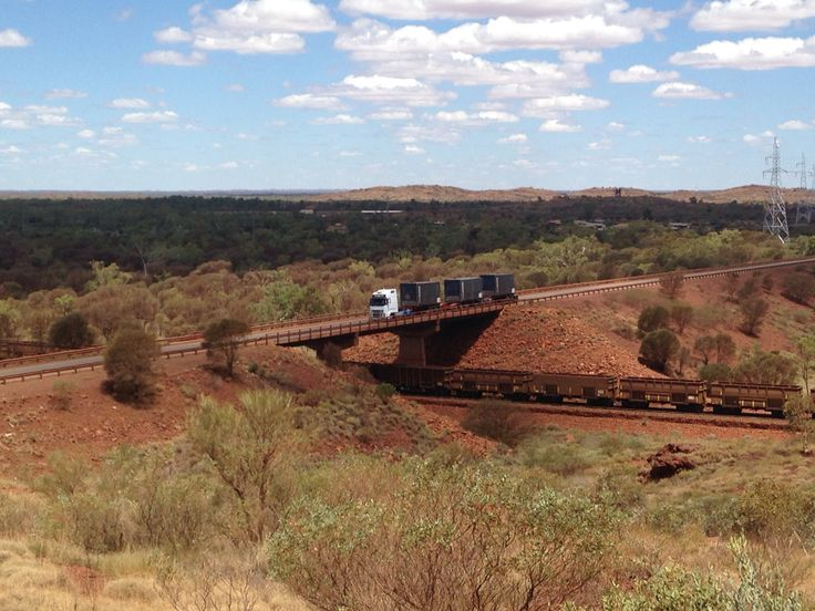 Road Train passing over the Iron Ore train.