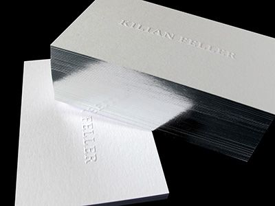 Silver foil edging, heavy soft paper, blind emboss serif type ... klasse!