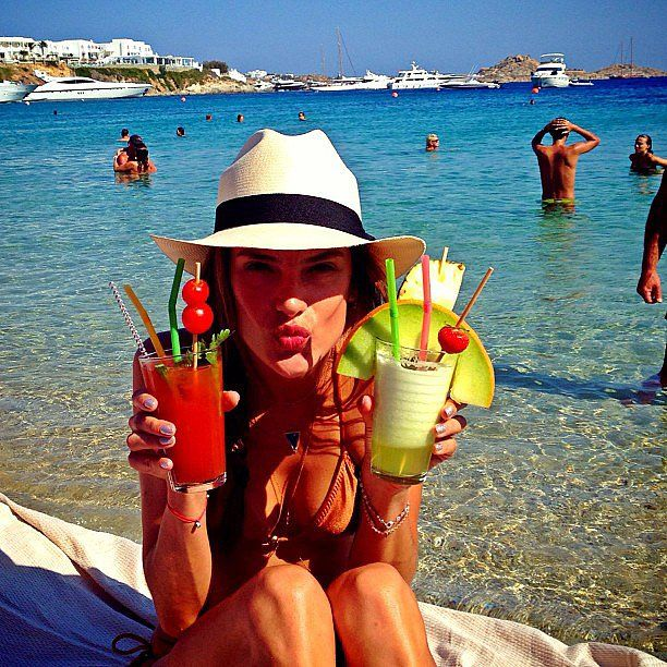The beautiful Alessandra Ambriosio enjoying #cocktails at the beach in #Mykonos... my dream holiday!!!