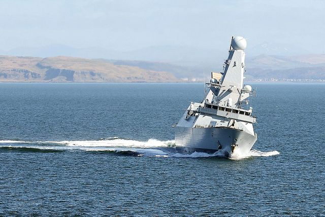 Royal Navy Type 45 destroyer HMS Diamond is pictured turning at speed during Exercise Joint Warrior off the coast of Scotland.
