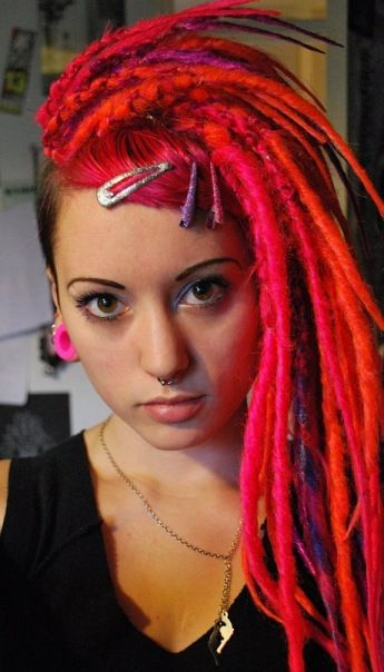 Dread Artist Unknown. Check out Filthy's Synthetic Dreads red orange pink rainbow syntehtic dreadhawk
