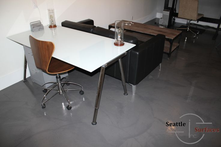 Concrete micro topping office floor after removal of glue for Microtopping costi