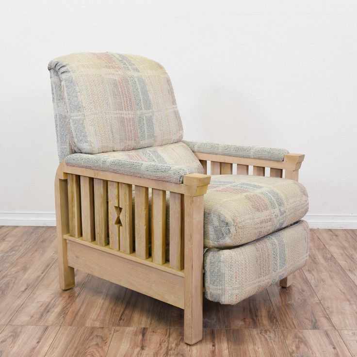 """This retro """"Barcalounger"""" recliner is featured in a solid wood with a light ash blonde wood finish. This Morris style armchair is in great condition with carved wood slat arms, a reclining back and abstract pastel upholstered cushions. Comfortable chair perfect for lounging! #retro #chairs #recliner #sandiegovintage #vintagefurniture"""