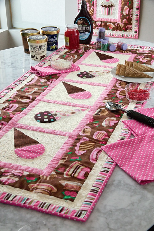 Adorable Ice Cream & Cake runner by Diane Nagle featured in the June/July '12 issue of Mccall's Quick Quilts. The runner features fabrics from Dan Morris' Sugar Rush.