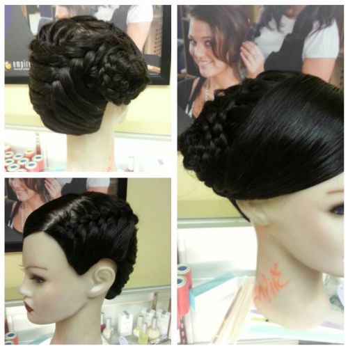 Yadira Sandoval, a student at Empire Beauty School in Lakewood, CO, created this braided updo. #updo #braids #EmpireBeautySchool #bridalupdo