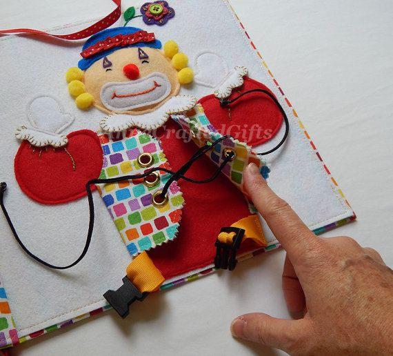 This fun, handmade toy for little kids is a great gift idea. Also creative ideas for your own felt quiet book page.  The circus clown helps children learn to tie a bow, buckle, and use snaps. #AnneCraftedGifts