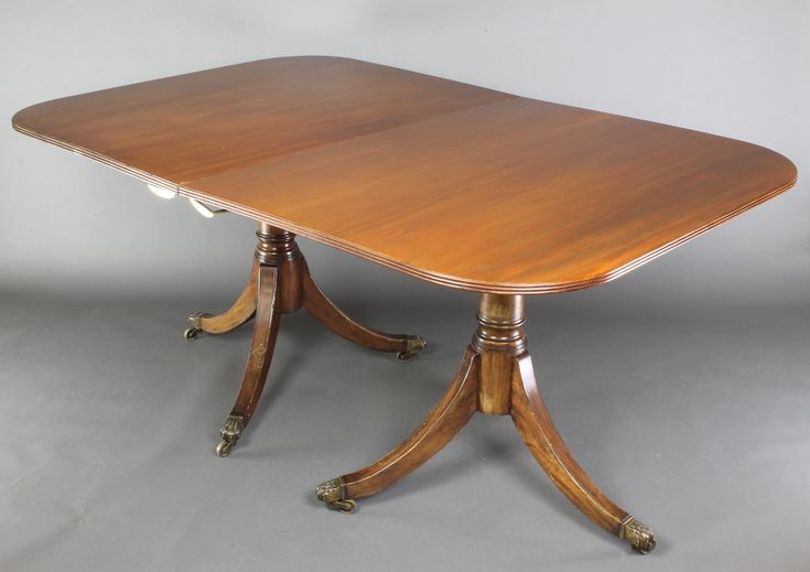 """Lot 881, A Georgian style mahogany twin pillar D end extending dining table with 1 extra leaf, 29 1/2""""h x 42""""w x 64""""l x 87 1/2""""l with extra leaf, est £200-300"""