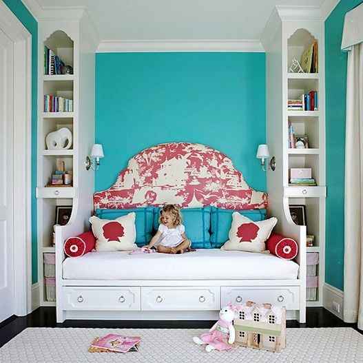 Love the way the sides of the bookcases become an enclosure for the bed, also doing double duty to hold the lights. And of course my favorite blue/aqua and white. Love the pop of color with the fuschia, although I would have chosen coral. Great storage with the bed drawers.