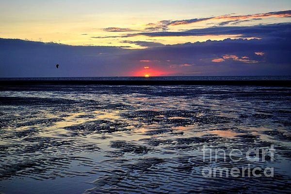 Sunset in Zeeland after a tide.
