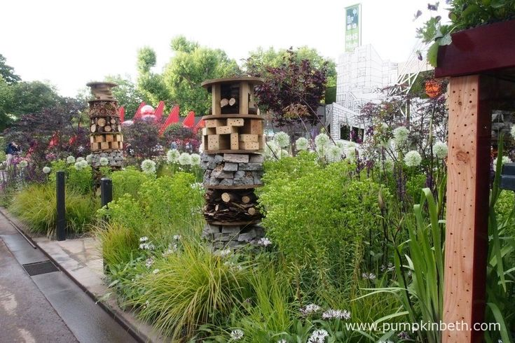 Detail showing holes drilled for insects on the Greening Grey Britain Garden, designed by Professor Nigel Dunnet, demonstrates creative approaches to sustainable garden design, at the RHS Chelsea Flower Show 2017.