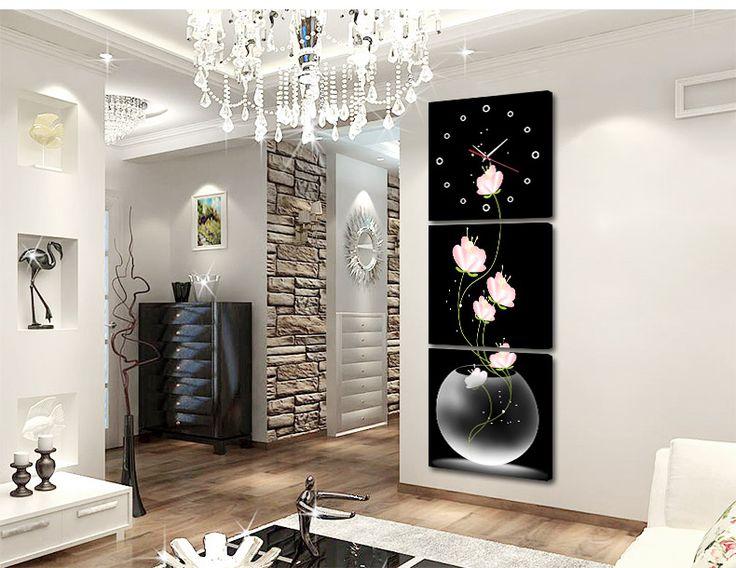 Современный вход гостиной тройные бескаркасных картины висят часы вертикальной…