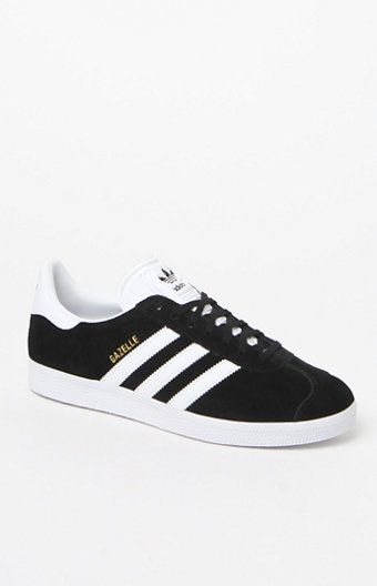 A classic indoor soccer shoe gets a modern rendition in the adidas Black & White Gazelle Sneakers. These women's sneakers are defined by a pigskin leather upper that lends a smooth, suede feel, a black-and-white finish, thick rubber sole and serrated 3-Stripes at the sides.   Lace-up Low profile Pigskin leather upper Synthetic lining for comfort Synthetic 3-Stripes and tongue Rubber outsole Imported