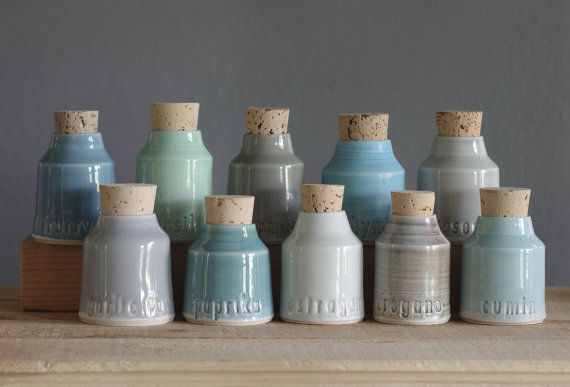 made to order spice bottles set of five. your choice of spice or herb names to be impressed into the bottles. this small corked bottle set is made of porcelain clay and glazed with shades of grey, blue, white and neutral colors, and natural cork stopper. impressed with the herb or spice name of your choice. marked on the underside with the vitrifiedstudio symbol impression.  approximate size- (not including cork height) 2.75 diameter x 3.25 height  please include your text requests in the…