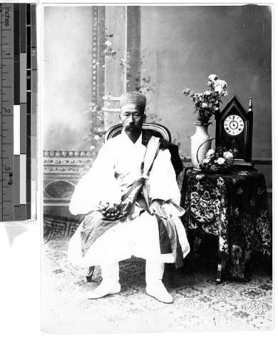 Portrait of a man seated next to a clock, Korea, ca. 1920-1940 :: International Mission Photography Archive, USC. (High res available at site)