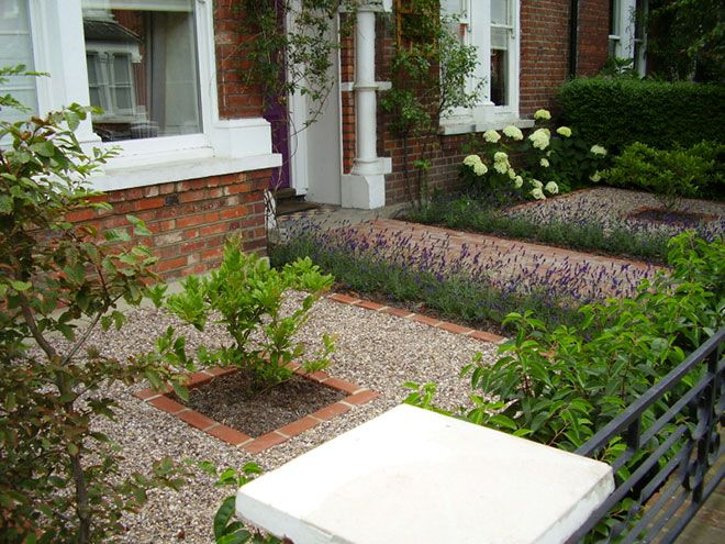Gravel and brick front garden with lavender and focus shrub