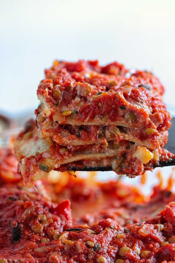 This is the BEST Vegan Lasagna! It consists of four layers: lentil bolognese sauce, cooked lasagna noodles, almond ricotta cheese, and roasted vegetables.