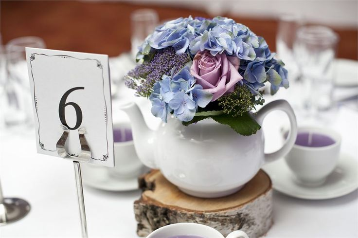 Get creative with your decor and use vintage items like teapots and teacups filled with flowers for whimsical DIY centrepieces!  Venue: Pelham House