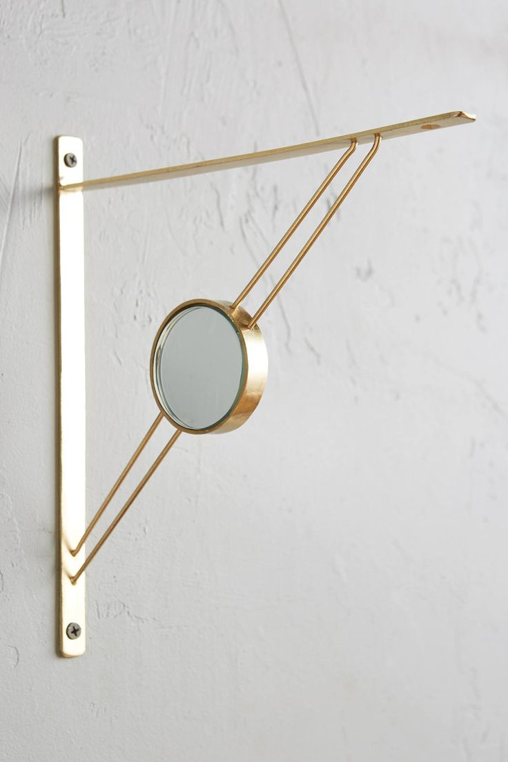 Gold and brass fixtures and faucets promising or passe apartment - Mirrored Metallic Bracket