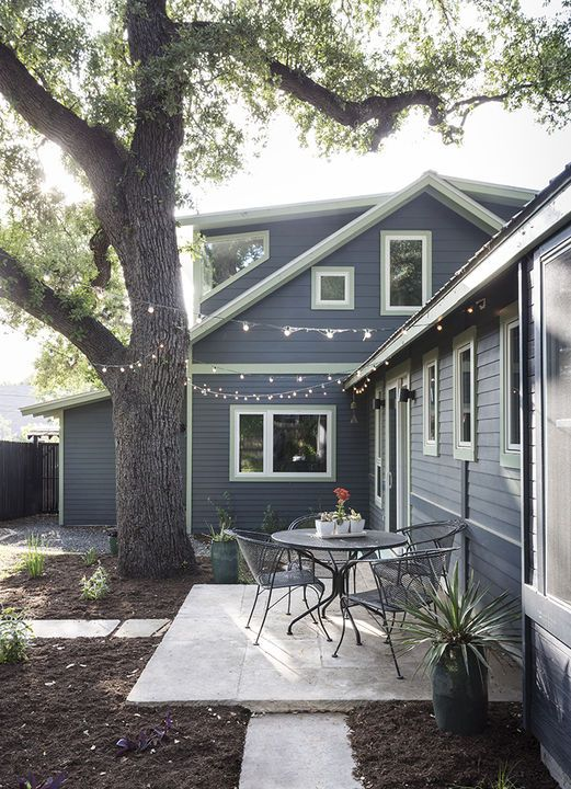 Architect J.C. Schmeil added over 1,000-square-feet to a tiny 1935 Austin bungalow on a tight budget by utilizing plenty of salvaged materials, such as reclaimed travertine pavers for the patio. Courtesy of Whit Preston. This originally appeared in Family-Sized Addition for Renovated Austin Bungalow.