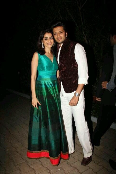 Genelia in a turquoise Indo-Western gown and Ritesh Deshmukh in a pantsuit. Indian Bollywood fashion.