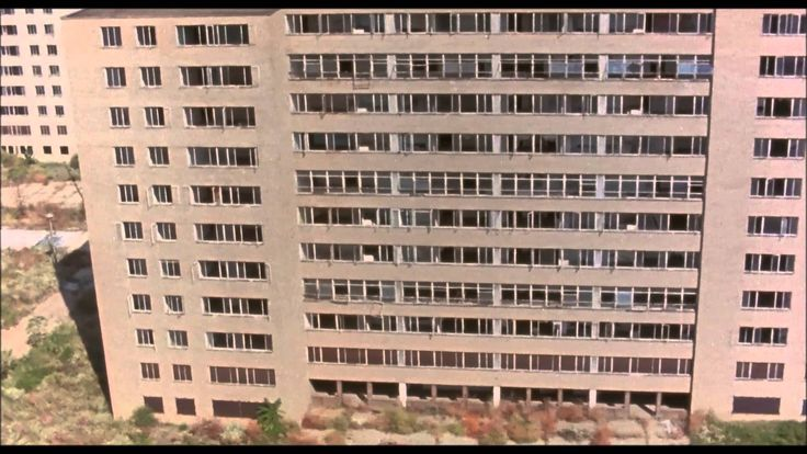 """Scene from """"Koyaanisqatsi"""" (1982) by Godfrey Reggio. Haunting images of destruction, decrepit buildings, and desolate places."""