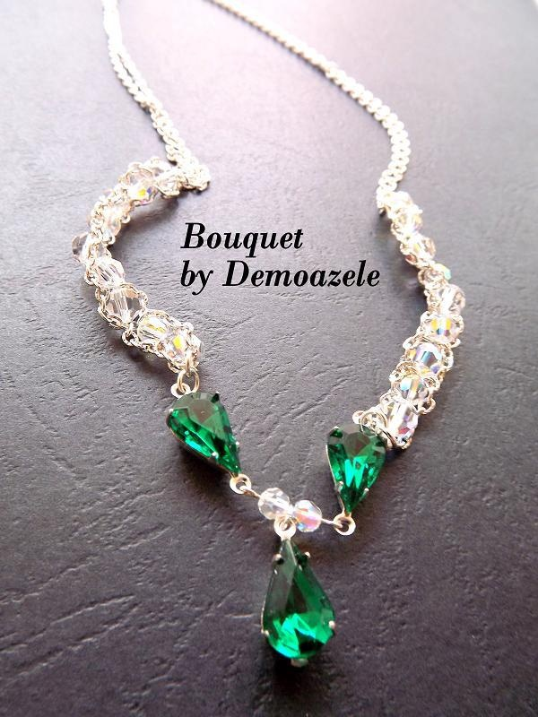 Jewelry made with Swarovski crystals in shades Aurora Borealis and Emerald. Media used for crystals in the necklace are coated with silver. The necklace is the neck. Jewelry can be made in other colors.