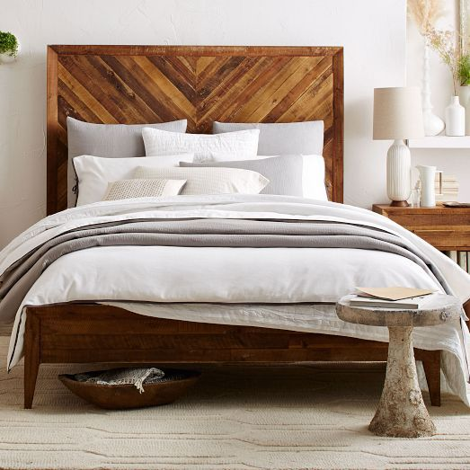 Crafted from reclaimed pine, our Alexa Bedroom Set imparts sophistication to naturalist style with its gently tapered legs, Brass finished hardware and a sky-high headboard with chevron wood-grain pattern.