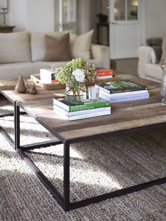 Entrance Level. Living Room. Coffee Table. Wood - darker (American walnut). Less Accessories on top - black, white, grey & green.