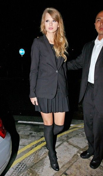 School Girl Crush........... While dining at Nobu, Taylor showed off her take on the school girl aesthetic. By keeping her outfit sleek and monochromatic, Taylor avoids turning the look into a cliché.  A pleated mini skirt looks adult paired with an on trend boyfriend blazer.