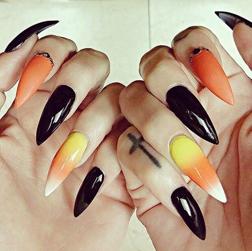 i would NEVER get this on my nails in a million years. but i do like the length and the shape so.
