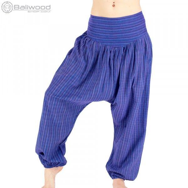 Sarouel ethnique à fourche haute. Ceinture de tissus sur l'avant et bande élastique sur l'arrière de la taille. Elastique à la cheville. Matière légère pour un été au frais. baba cool, vêtement large, ample, hippie, teuf, rave, festival, trance, burning man, festival de musique, jongleur, costume, vêtement unisexe, pantalon flottant, pantalon très large, magrheb, pantalon bouffant, entrejambe bas, pantalon en toile, afrique du nord, couleur, costume souple, violet