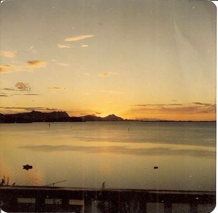 Whangarei Harbour at sunrise, with Mt. Manaia and Great Barrier Island in distance, from my boyhood home at Onerahi, New Zealand