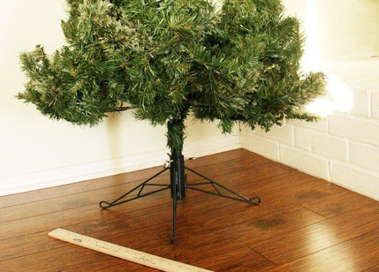 """See that ugly base? That darn tree skirt was causing me so many headaches."" So, look what she did instead!"