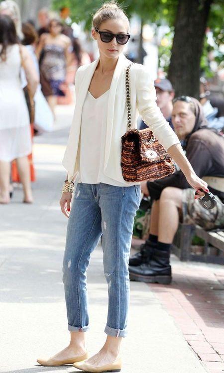 Olivia Palermo. Boyfriend jeans, white tuxedo jacket, tweed bag.